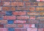 a wall of old brick